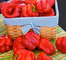 Bell peppers in a basket by Jeffrey  Sinnock