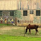 a horse in front of barn by Lynne Prestebak