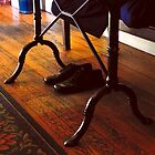 Shoes Under a Table by Jay Gross