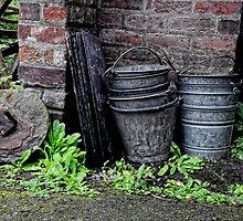 A Pile of Buckets. by Karen  Betts