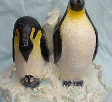 Emperor penguins family by Alex Gardiner