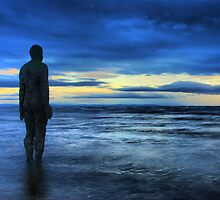 Statues on the beach by Ben H