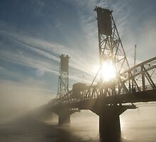 Hawthorne Bridge in Portland with fog and sun. by Andrew Ferguson
