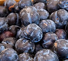 Fresh Plums at a farmers market by Jeffrey  Sinnock
