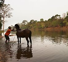 Horse and Master - Angkor Thom, Cambodia by Alex Zuccarelli