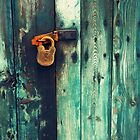 Rusty padlock by Astrid Authier