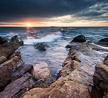 Sunrise at the Brigg, Filey by Photomh