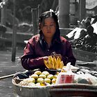 Woman at Floating Market by Gene  Tewksbury