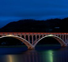 Rogue River bridge at night by Jeffrey  Sinnock