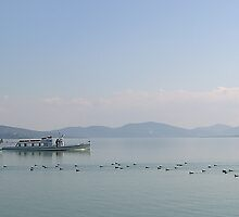 A steamer begins the day on Lake Trasimeno, Umbria, Italy by Philip Mitchell