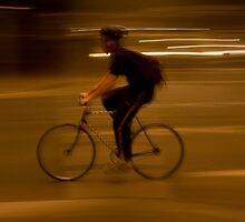 single cyclist in the dust by Front Quarter Window