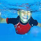 Boy Blowing Bubbles Underwater by Janette Rodgers