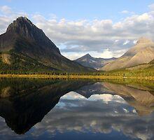 Swiftcurrent lake mirror by BILL JOSEPH
