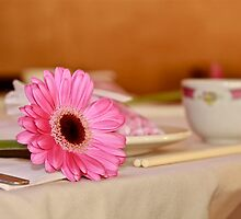 Flower at place setting. by Mario Alleyne