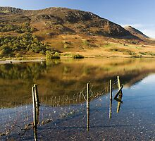 Reflections in Crummock Water by Jon Tait
