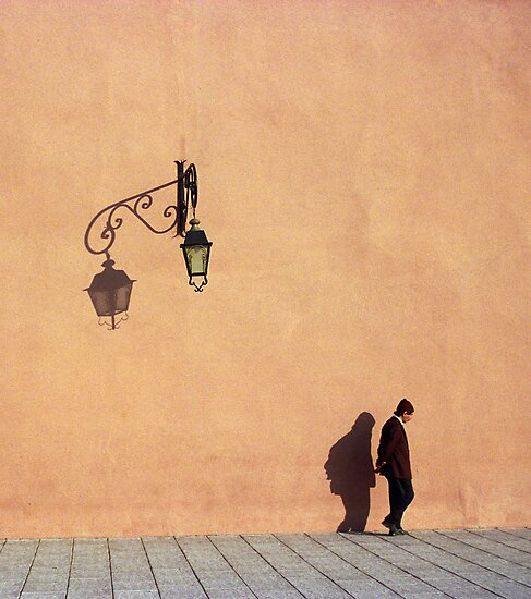 Man Passing by City Walls of Marrakech, Morocco  by Petr Svarc