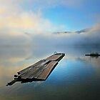 lakescape with low misty clouds reflected on blue by axieflics