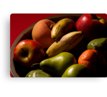 Bucket of fruit Canvas Print