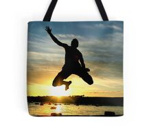 Leaping into the sea Tote Bag