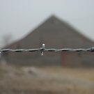 Barn with frosted barbwire fence in front by PhotoCrazy6