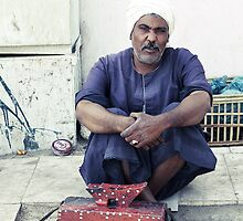 Shoe Shine Man - Luxor, Egypt by Anne Kingston