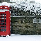 red phone box on a snowy London by laura-moreno
