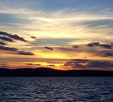 Sunset cruise on Lake Sebago. by William Brennan