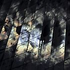 Kaleidoscope-reflections of sun and clouds in the glass facade by Peter Benkmann