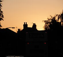 Haxby Rooftops- Red sky at night photographers delight by Olly  Pirozek