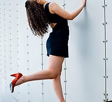 Dancer working the riveted wall #2 by Mark Elshout