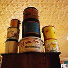 stacking cans by Lynn McCann