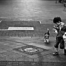 Little Boy With Little Dog by Uwe Rothuysen
