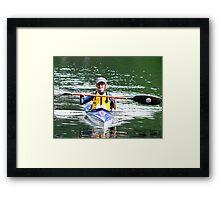 kid in a kayak Framed Print