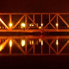 Train bridge at night by Bill Gamblin