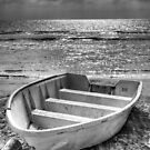 boat on beach by Carlos Restrepo