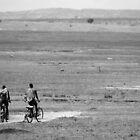 Masai on bikes - b&w by Paulo van Breugel