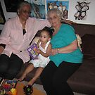 Katina w/2 grandmas xmas eve 09 by helene ruiz