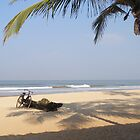 Benaulim Beach, with boat and bicycle, Goa, India by photoartindia