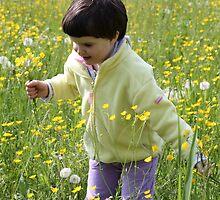 A happy child among the flowers by annalisa bianchetti