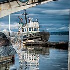 Tug Boat docked in the harbor by Rick Ruppenthal
