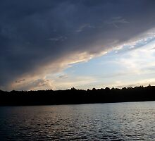 threatening sky by swimmer