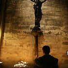 Crucifix and candles, Notre Dame, Paris by wichwetyl