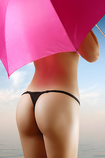 Sexy young woman with an umbrella by ArtNudePhotos