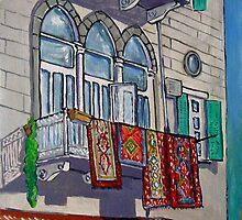 Balcony with Hanging Carpets by nancy salamouny