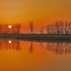 Reflections at sunrise by Adri  Padmos