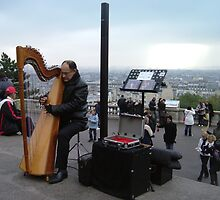Playing the harp outside Sacre Coeur by photosbyDavid