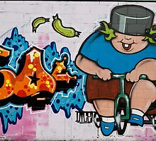 Big boy with one tooth  riding tricycle by yurix