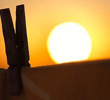 Clothes peg at sunrise by Gaspar Avila