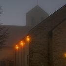 Winter Fog over a Church.... by Larry Llewellyn