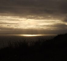 Sun breaking through cloud over the Atlantic Ocean at the Cliffs of Moher, Ireland by CFoley